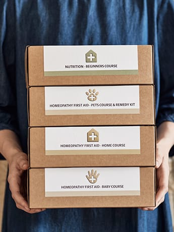 Homeopathy First Aid Course boxes in hands