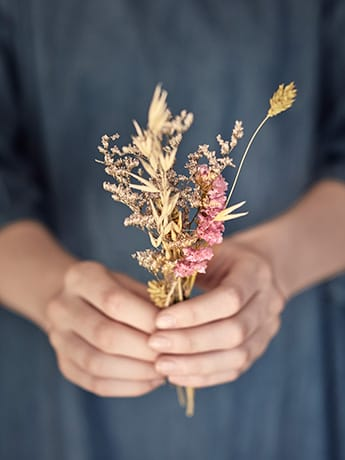 Dried flowers in hand
