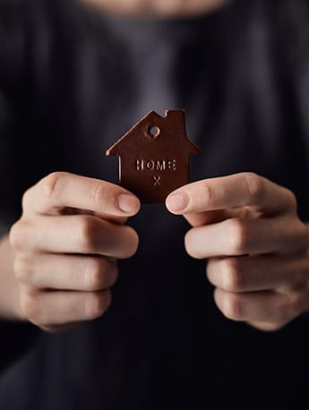Homeopathy Home sign in hands