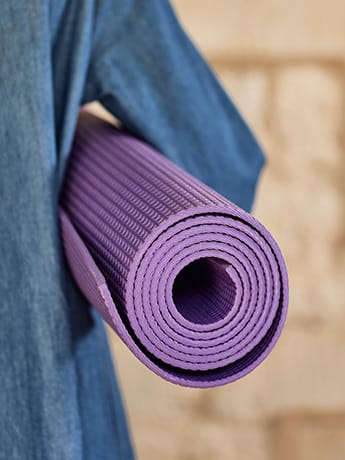 Yoga course mat under arm